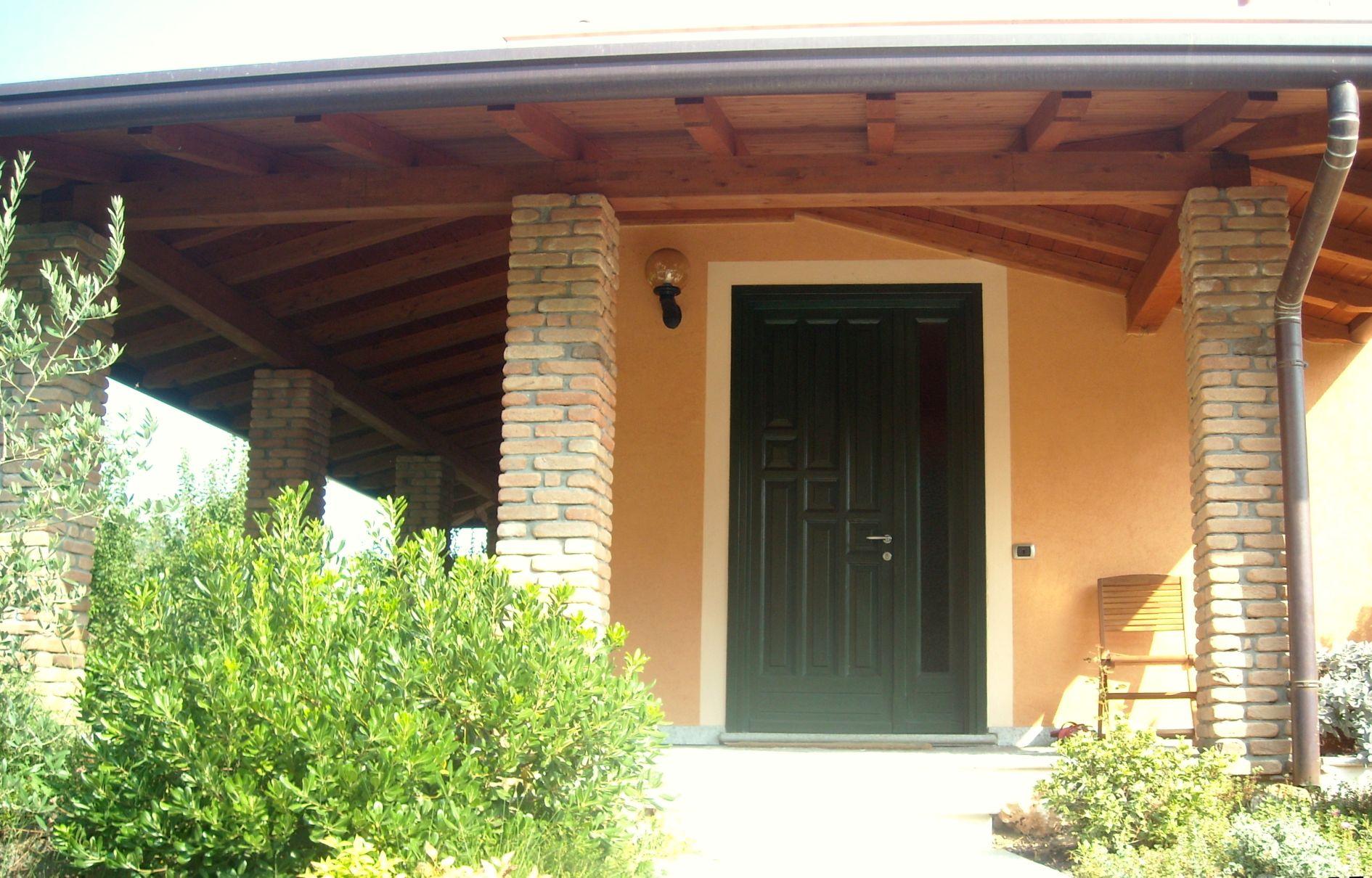 Protezione del porticato esterno for Piani di casa del sud avvolgono portico